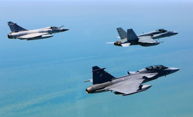 Air to Air formation with a JAS-39D Gripen from the Royal Thai Air Force, Mirage 2000 from the United Arab Emirates and an F/A-18A Hornet from the Royal Australian Air Force.