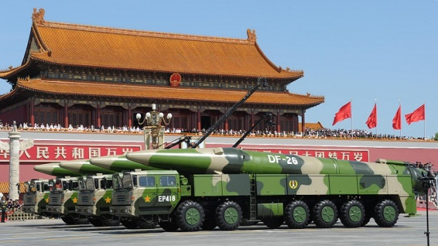 Military vehicles carrying missiles march at the Tiananmen Square during a military parade to mark the 70th anniversary of the end of World War Two, in Beijing, China, September 3, 2015. China's President Xi Jinping and world leader inspected 12,000 troops marching across the square. ( The Yomiuri Shimbun via AP Images )