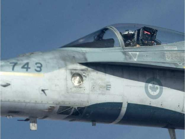a-royal-canadian-air-force-cf-18-hornet-is-refueled-by-a-kc